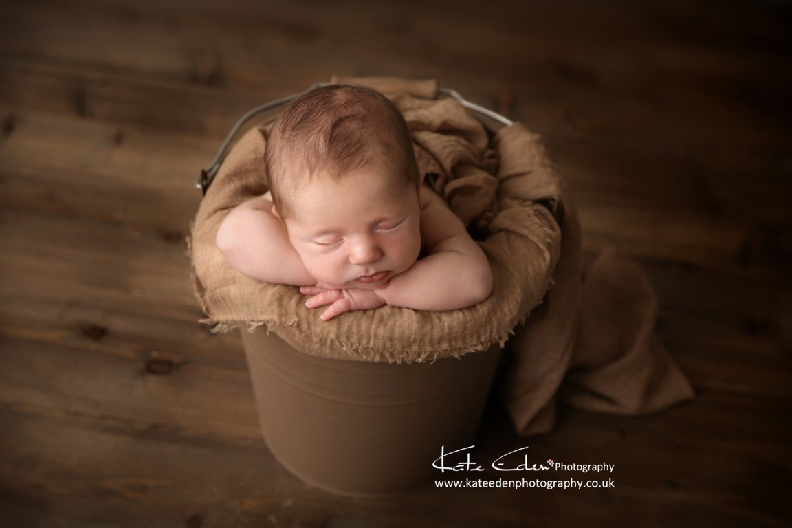 Newborn baby in the bucket - newborn posing - Kate Eden Photography