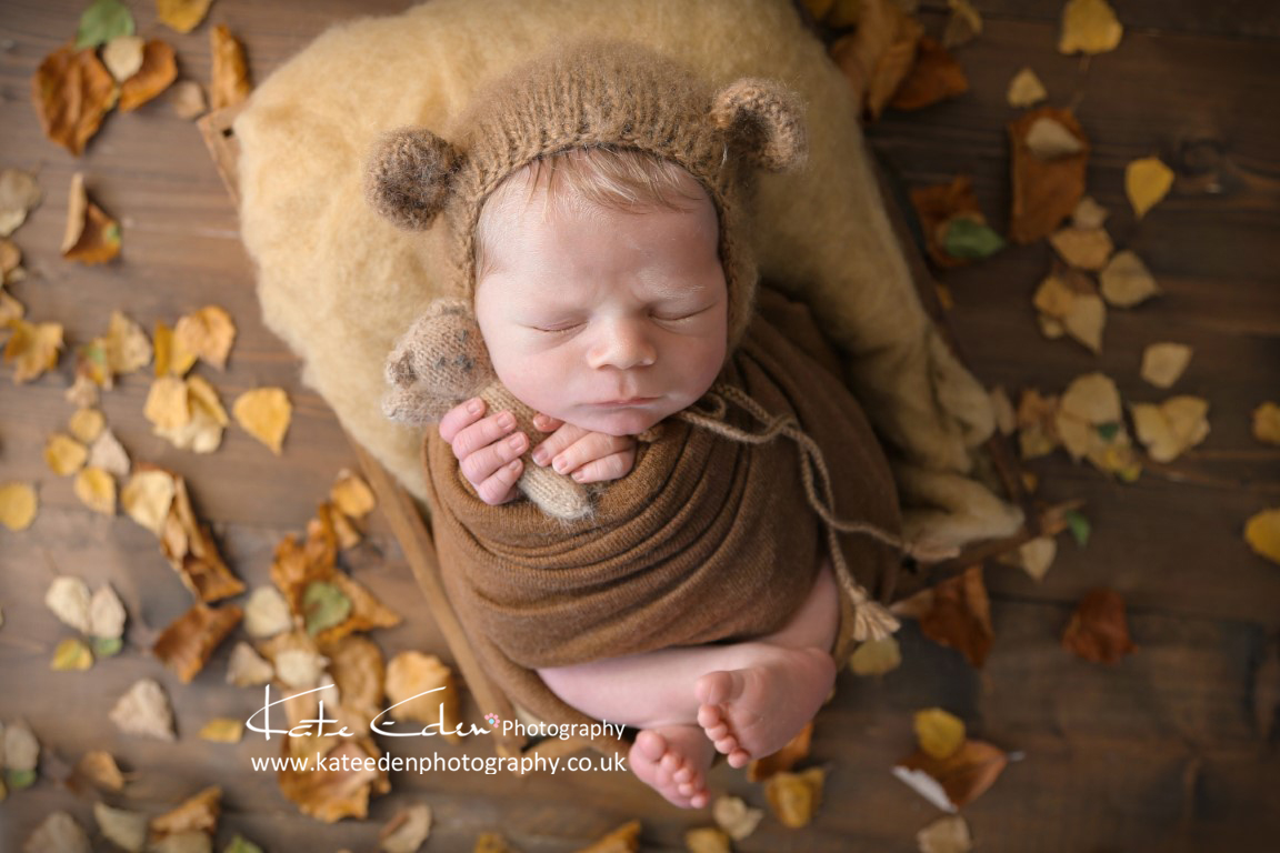 Newborn baby in autumn colours