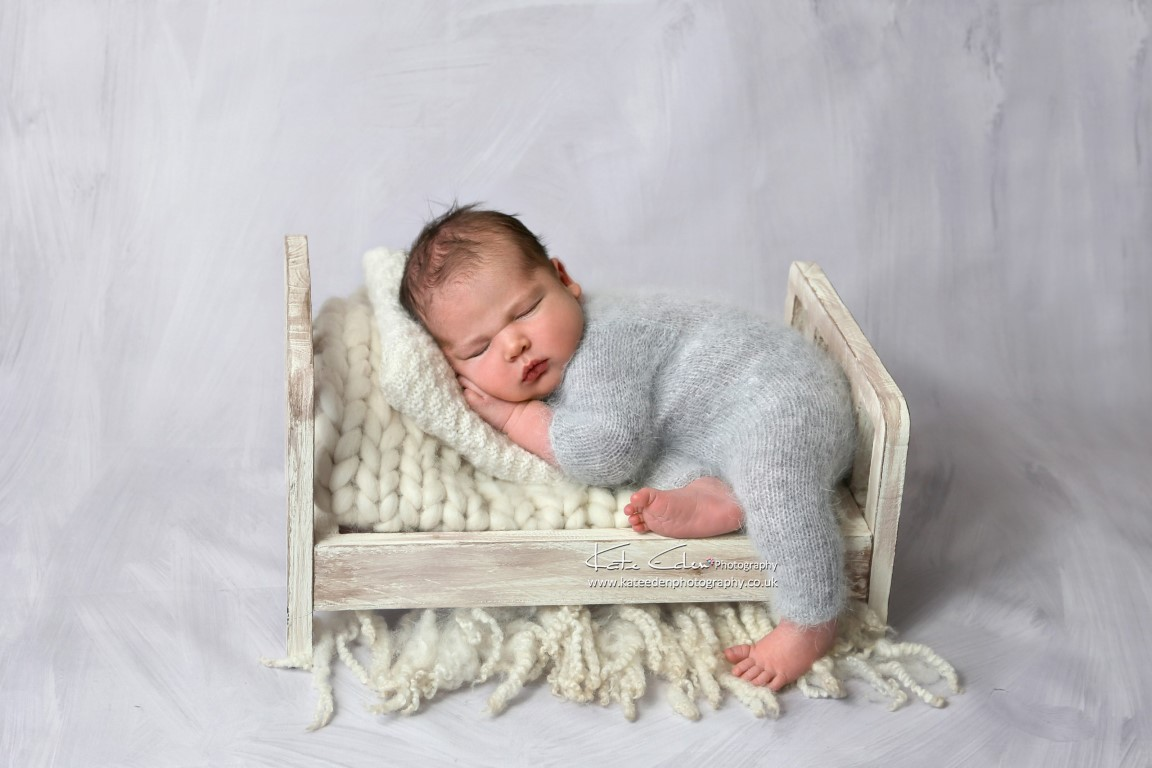Newborn baby in the mini-bed - Kate Eden Photography - Milton Keynes newborn photographer