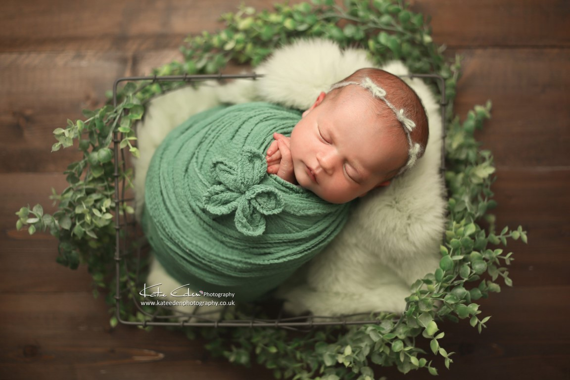 Newborn baby girl in green - London newborn photographer - Kate Eden Photography