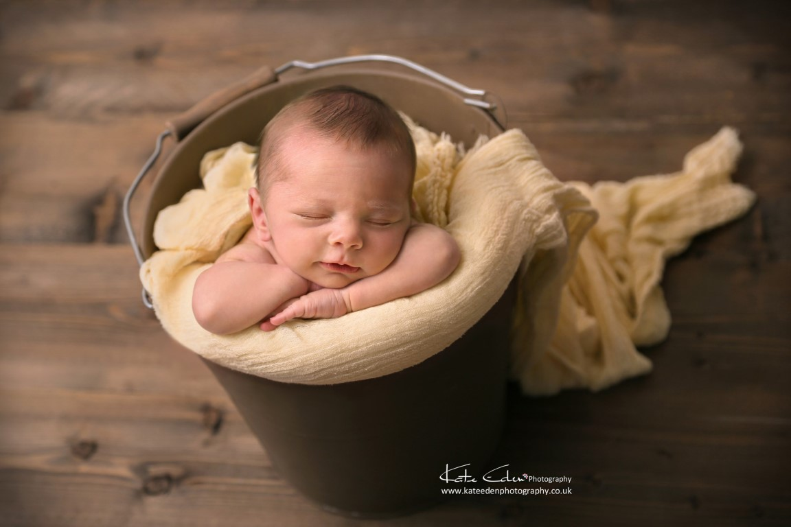 Newborn baby in the bucket - Kate Eden Photography - Milton Keynes baby photographer