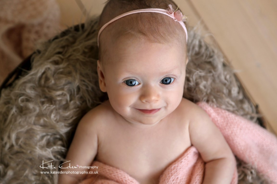 baby girl with lovely big eyes - baby photographer Aberdeen