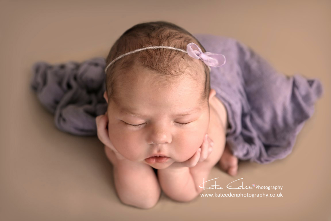 Newborn girl frog pose
