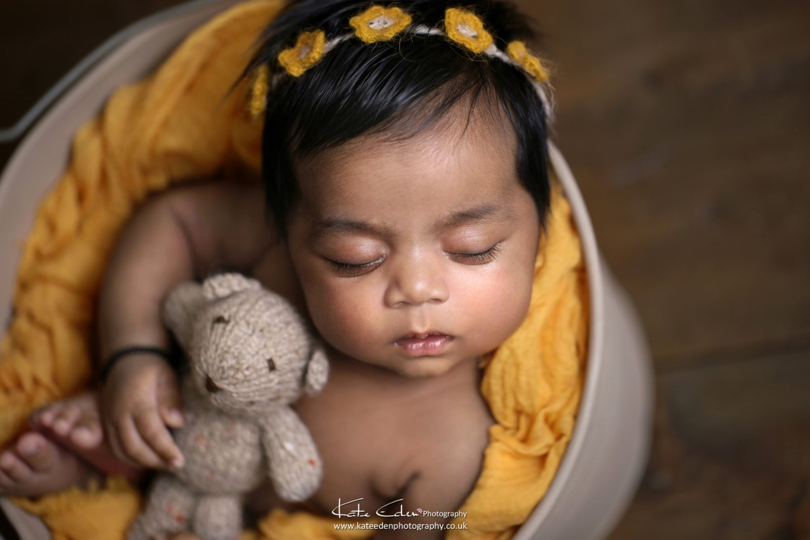 Newborn baby girl in yellow - Kate Eden Photography - Milton Keynes newborn photographer