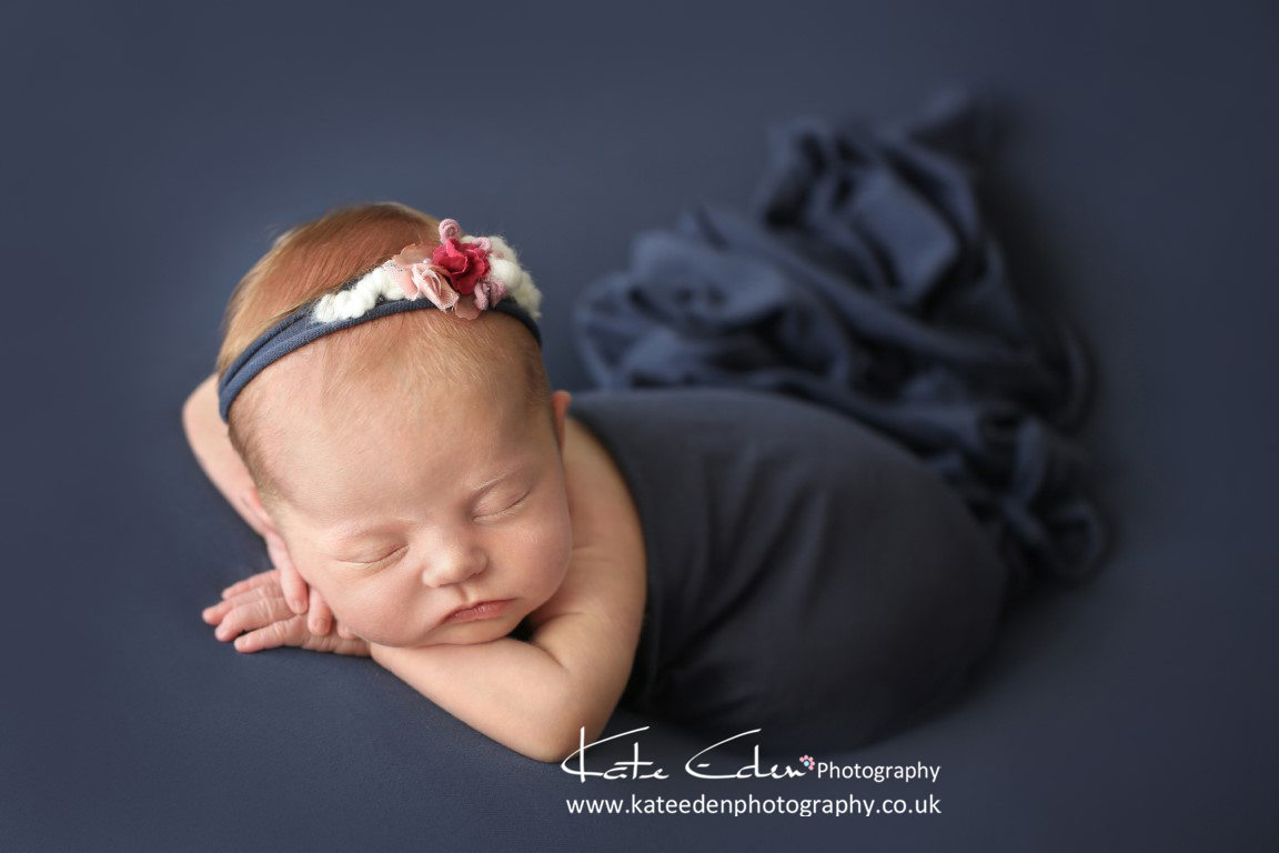 Newborn baby girl in blue