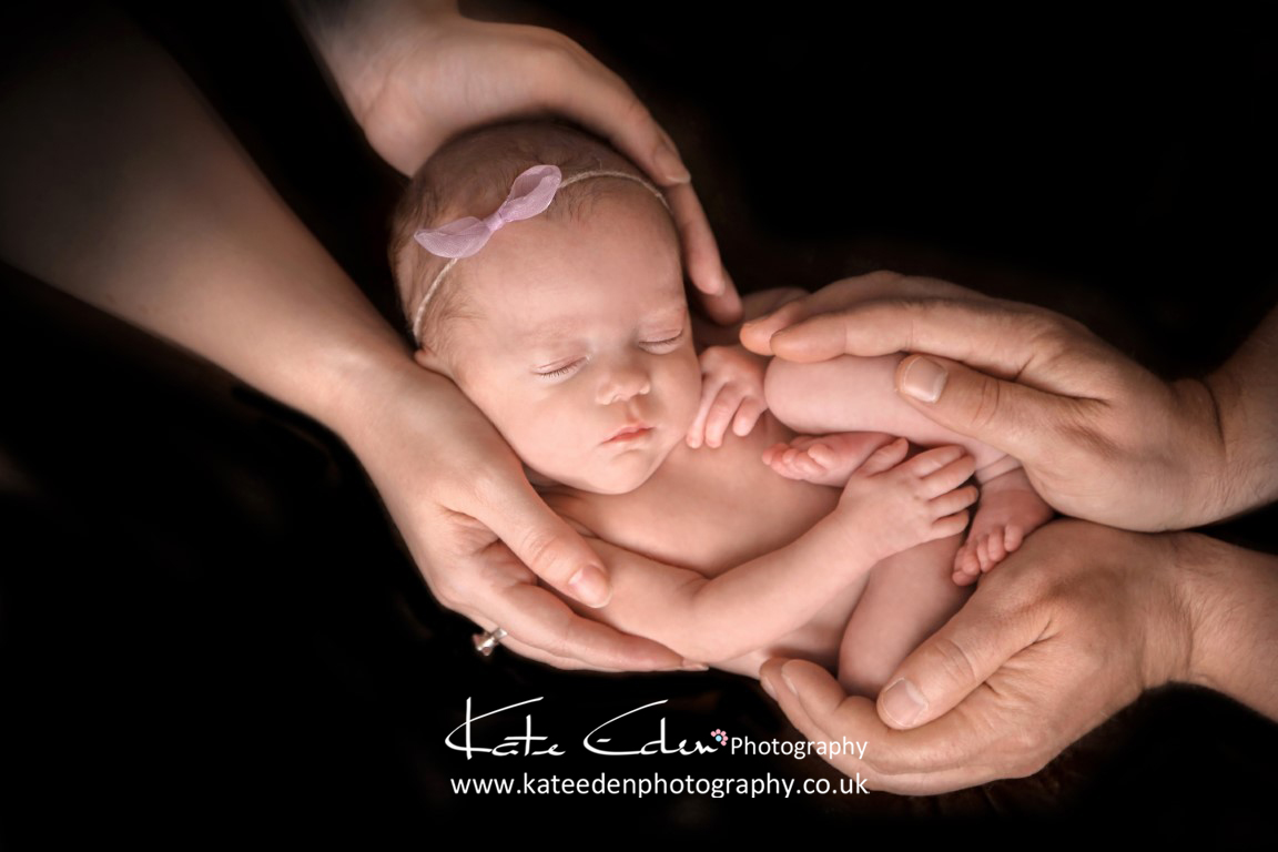 Newborn in parents hands
