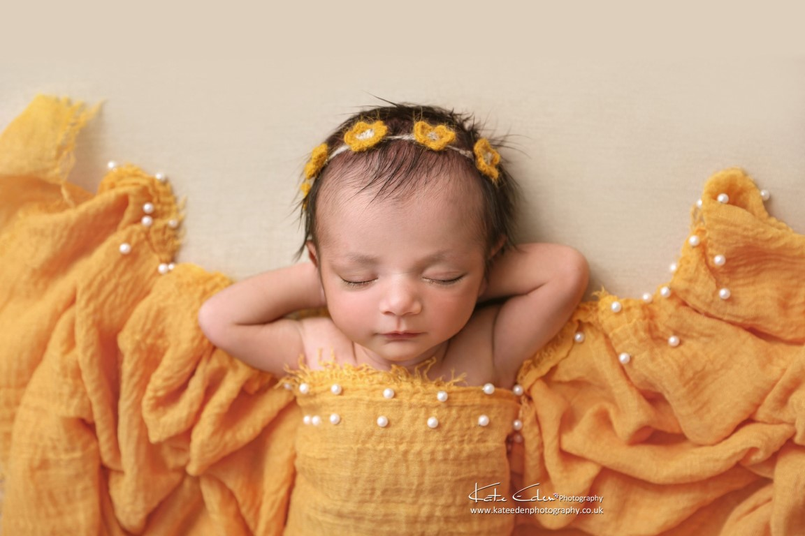 Newborn baby in yellow - Kate Eden Photography