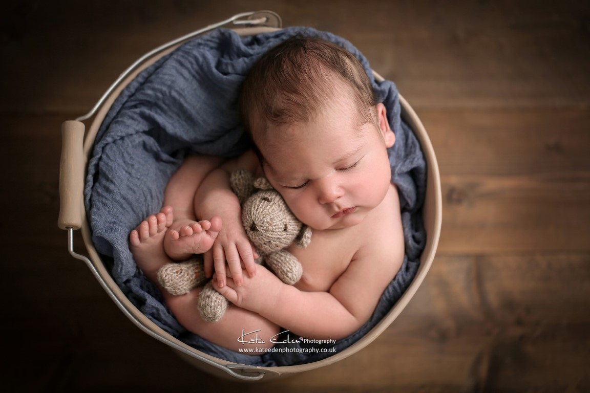 newborn baby boy with his teddy bear in blue - Kate Eden Photography - Milton Keynes