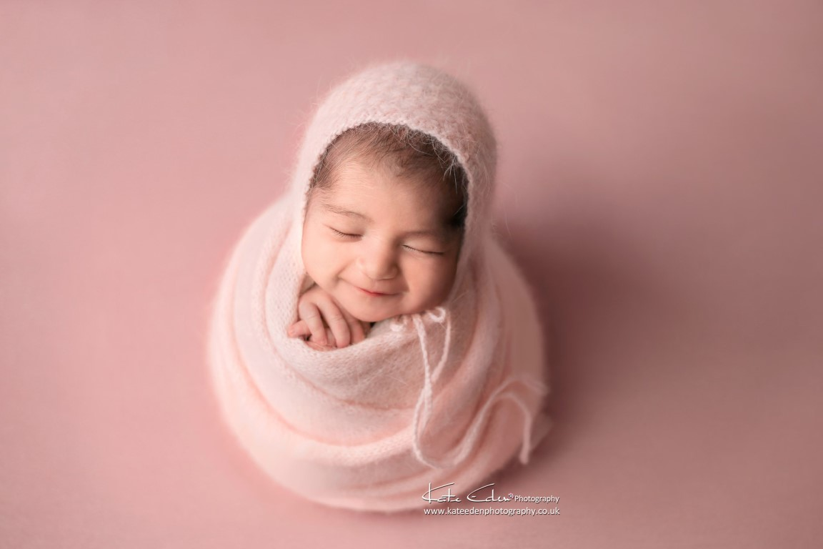 Newborn baby girl in pink - Kate Eden Photography - Buckinghamshire newborn photographer