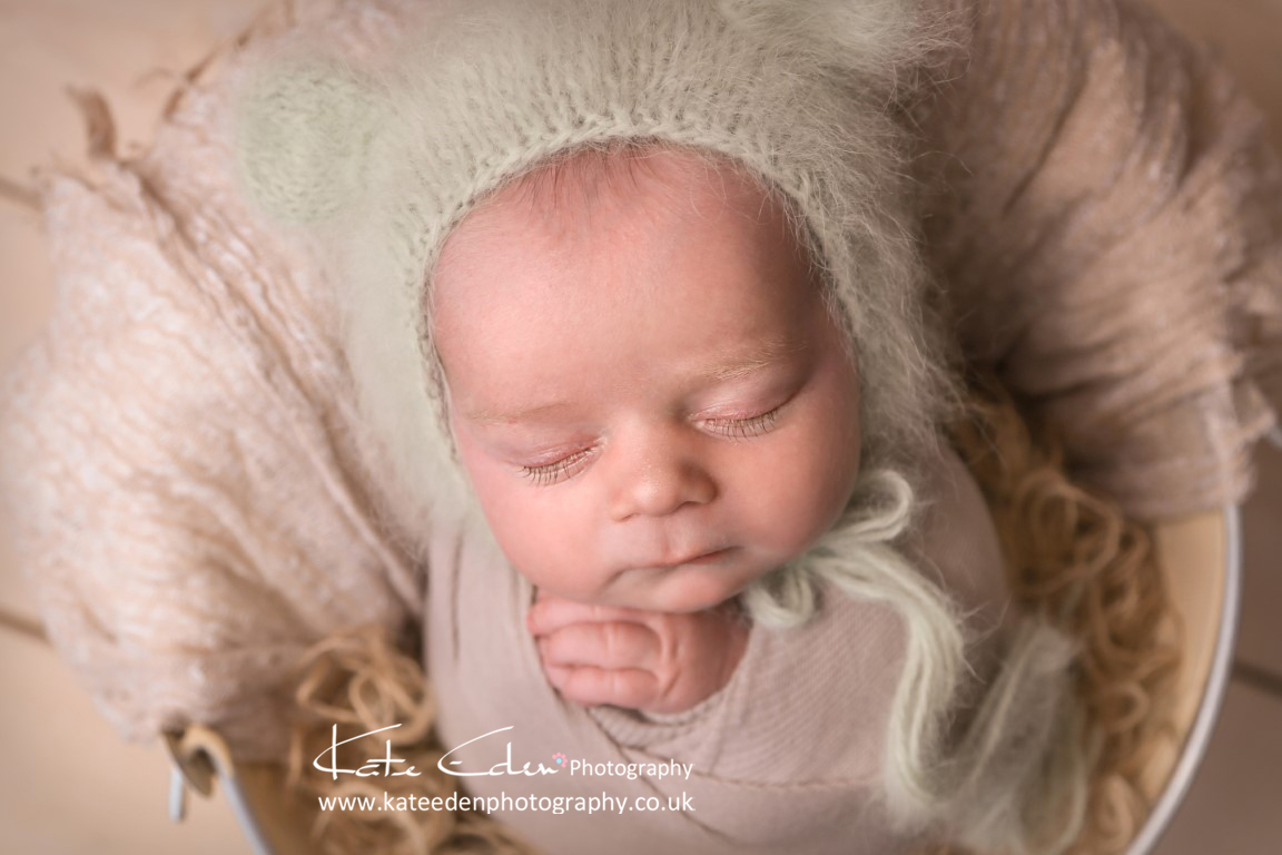 A newborn baby with long lashes