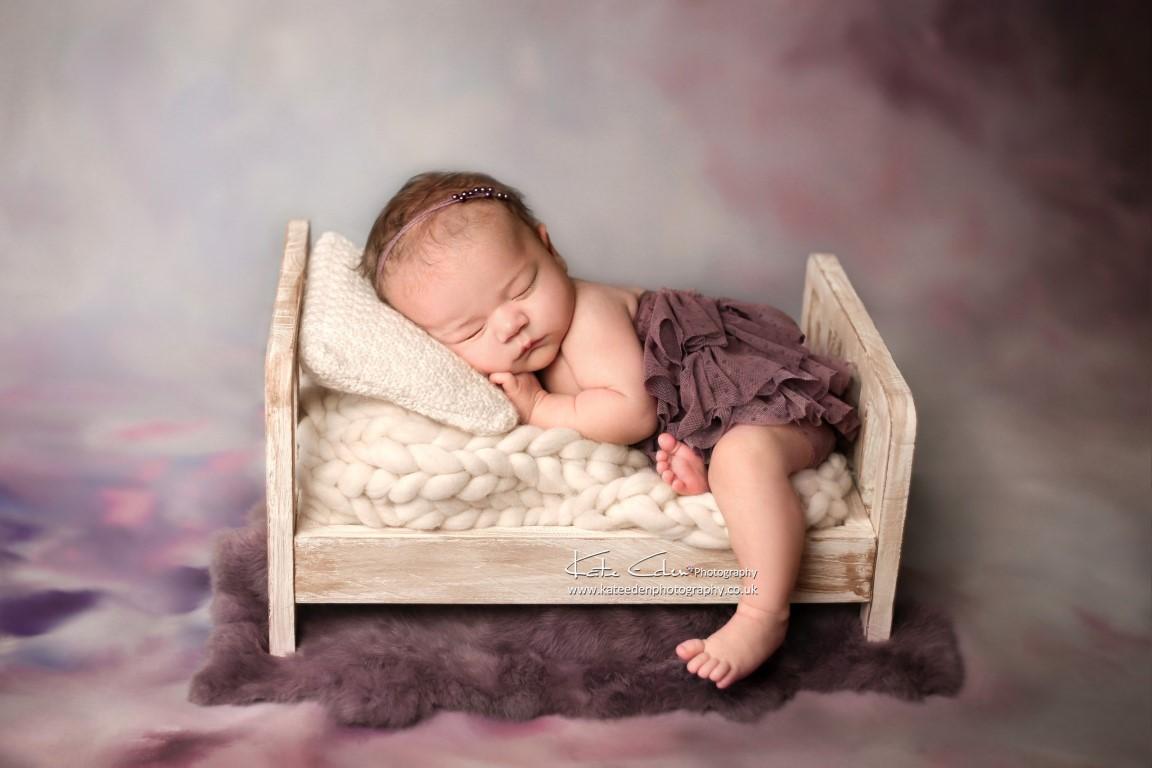 Newborn baby in miny bed - Kate Eden photography - Milton Keynes, London, newborn photographer