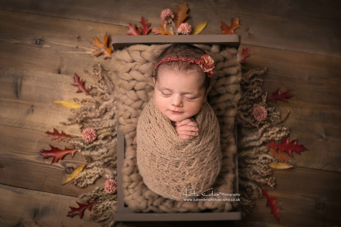 An adorable newborn girl in Autumn leaves - Kate Eden Photography -Milton Keynes
