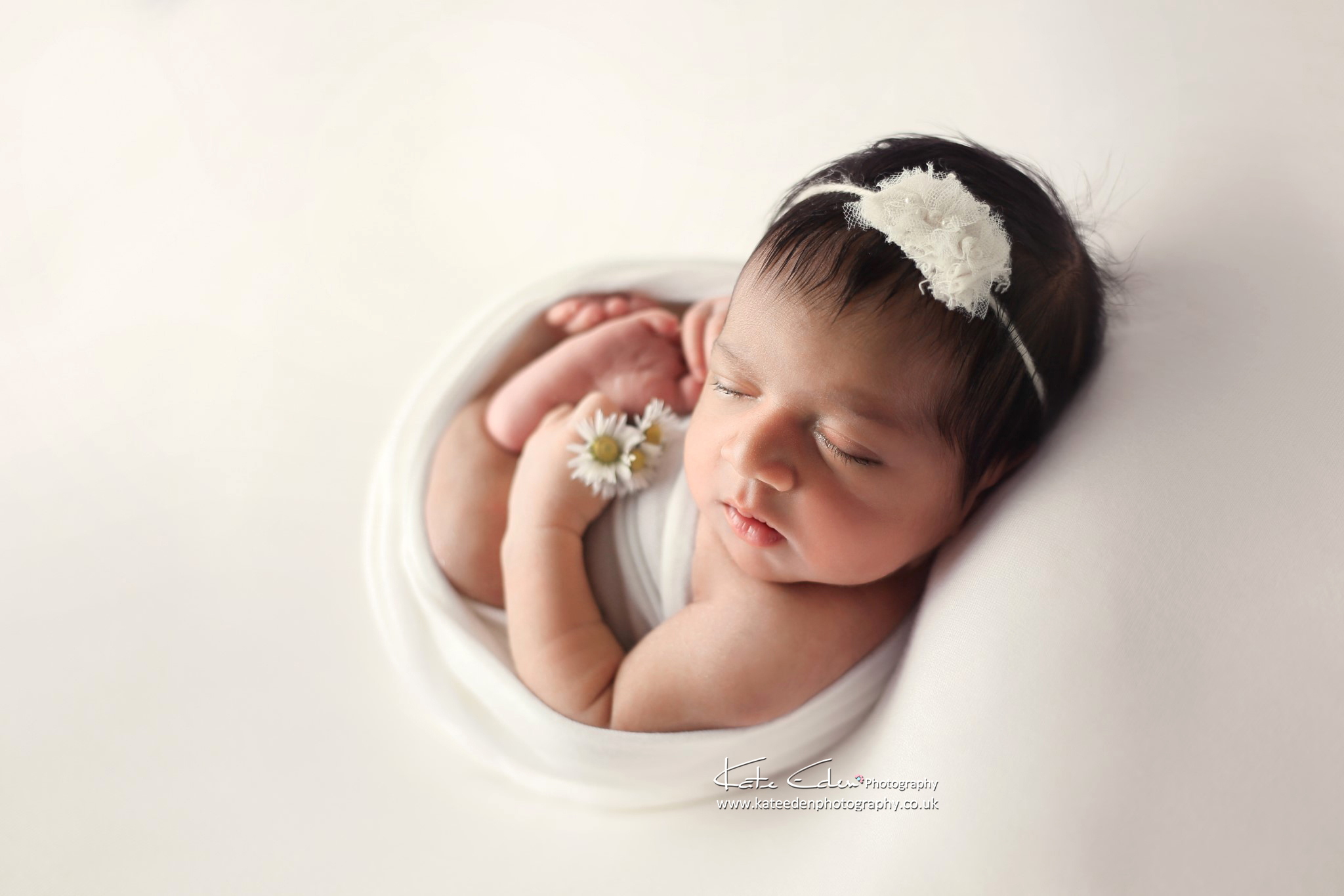 Newborn baby girl in white - London newborn photographer - Kate Eden Photography