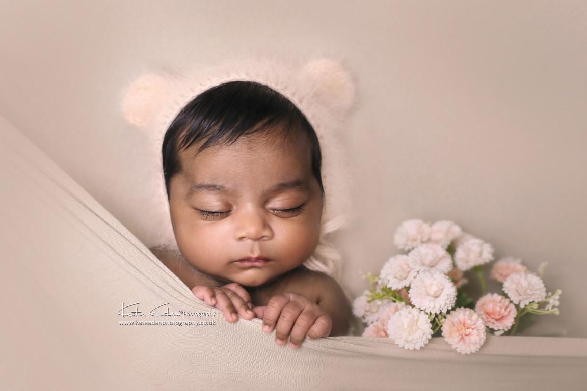 Newborn baby girl with flowers - Kate Eden Photography - Milton Keynes newborn photographer