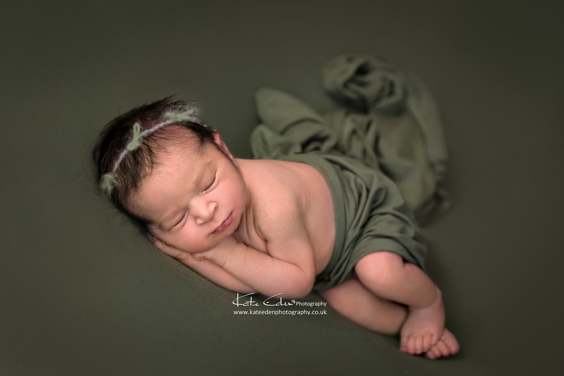 Newborn baby girl in green - Kate Eden Photography