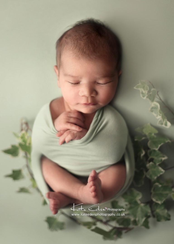Baby boy in green - Kate Eden Photography - Milton Keynes newborn photographer
