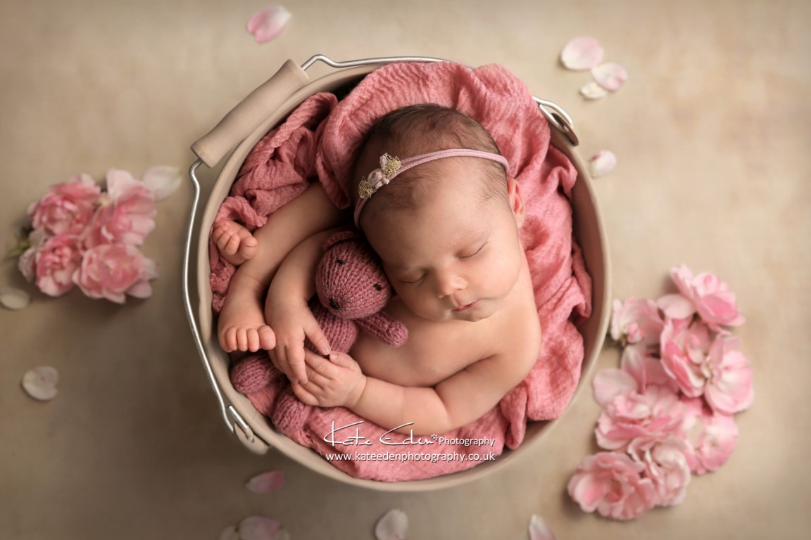 Newborn photography - a baby girl with pink flowers - Kate Eden Photography
