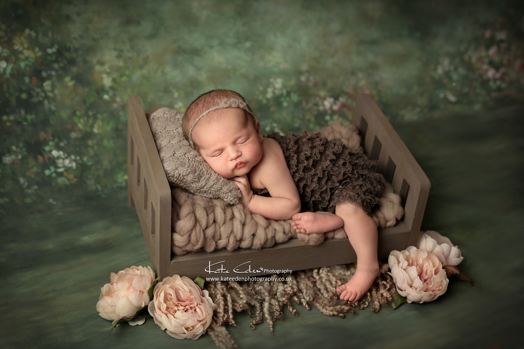 Newborn baby girl in a little bed - Kate Eden Photography - Milton Keynes photographer