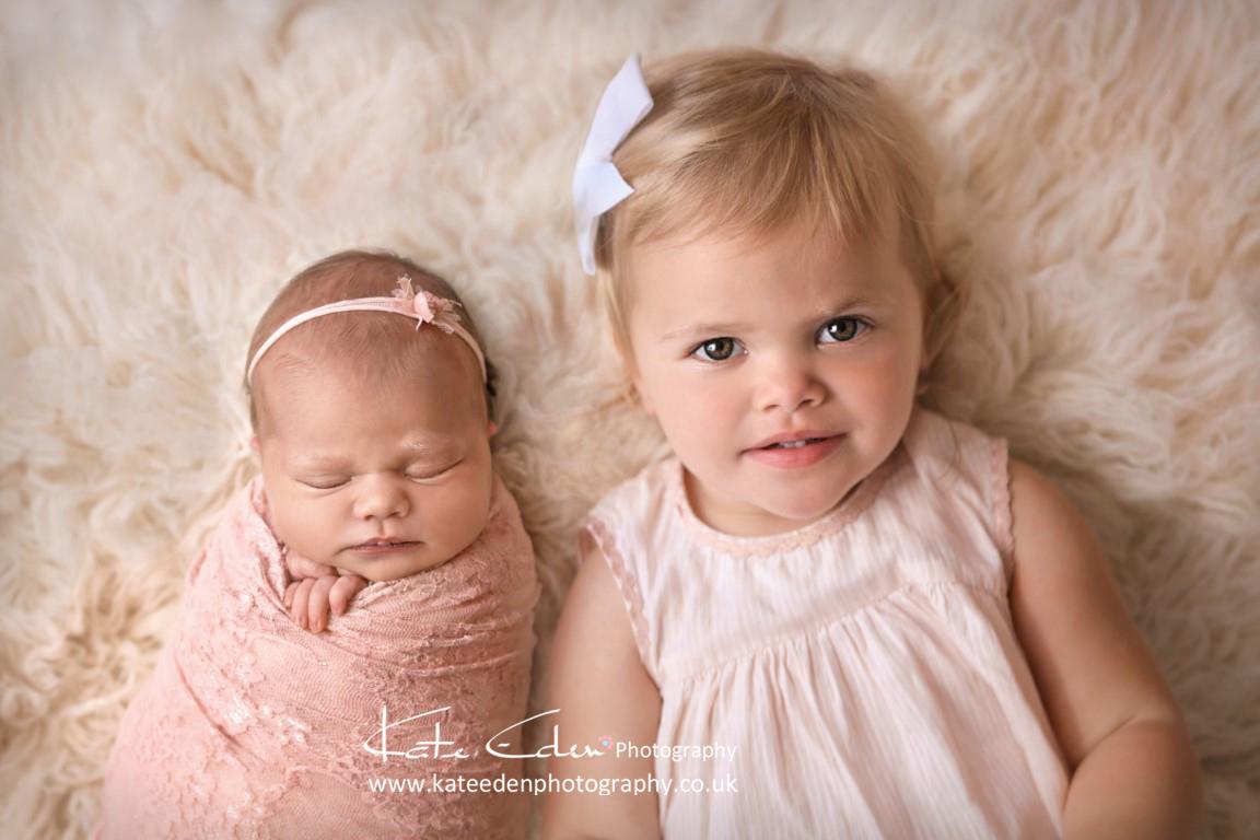 Cute baby sisters