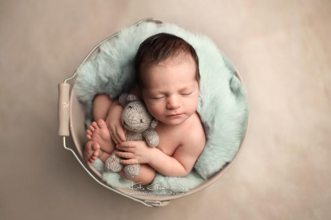Newborn baby in the bucket - Kate Eden photography - Milton Keynes newborn photographer