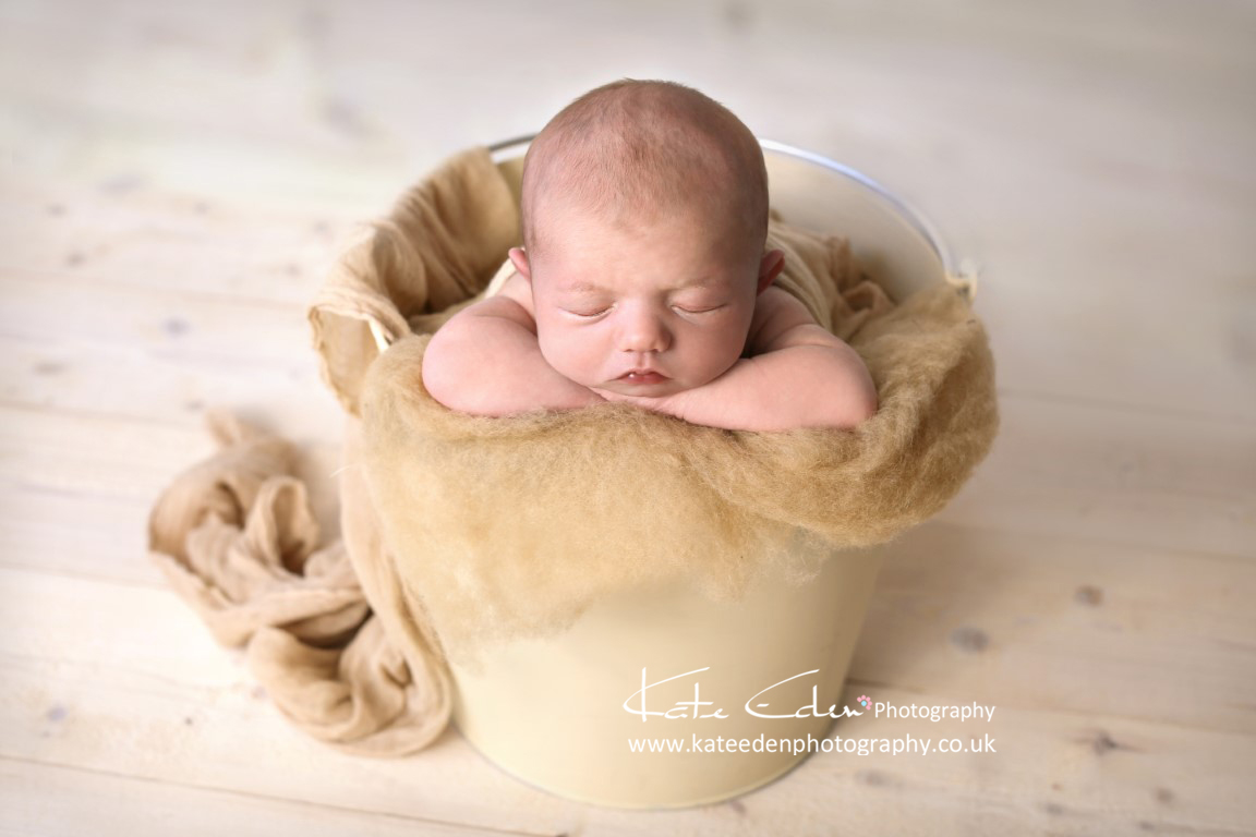 Newborn baby in the bucket