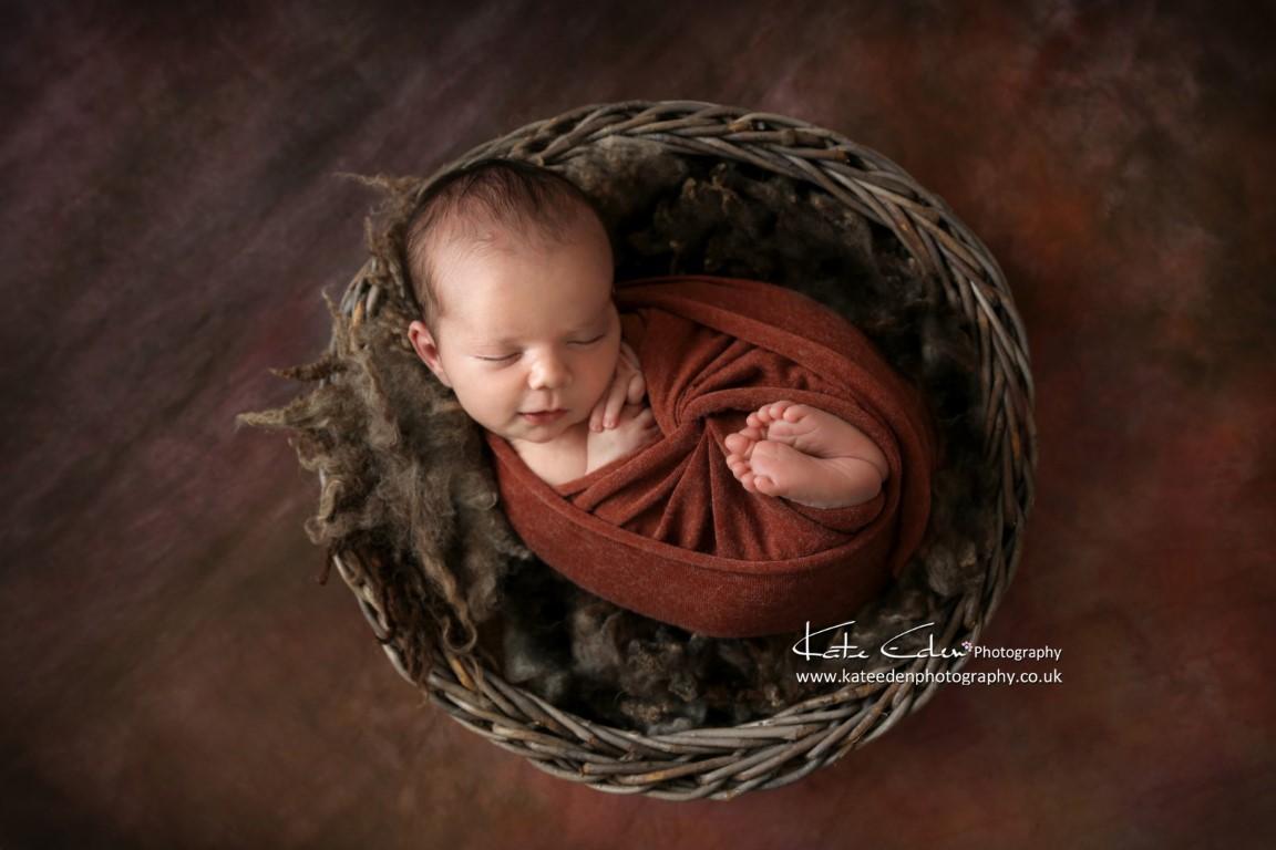 Newborn baby boy in Autumn colours - Kate Eden Photography