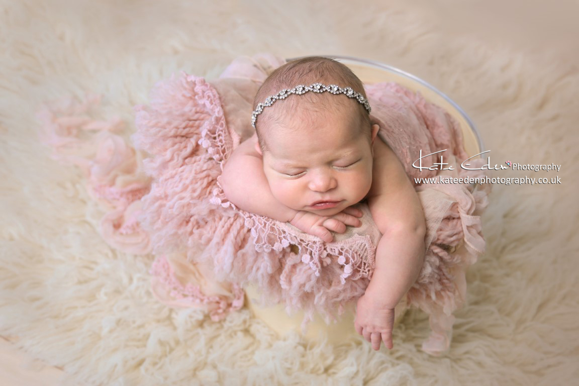 A newborn girl in the bucket, newborn photography Aberdeen