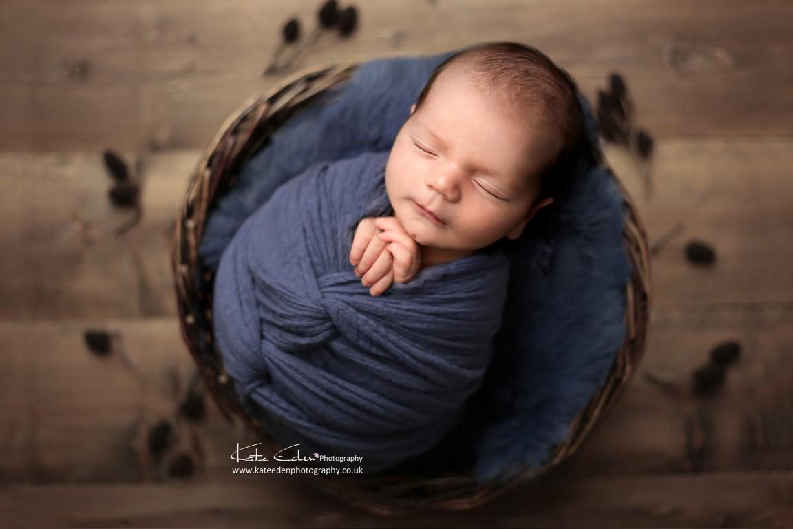 Newborn baby boy in blue - Kate Eden Photography - Milton Keynes newborn photographer