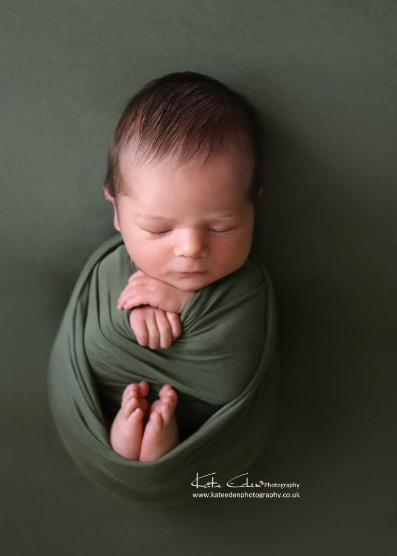 Newborn baby boy in green - Kate Eden Photography - Milton Keynes newborn photographer