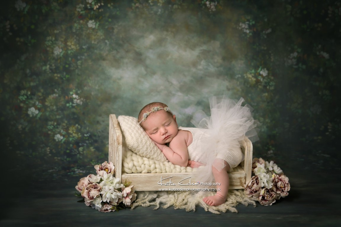 Newborn baby girl in mini-bed - newborn photography - Kate Eden Photography